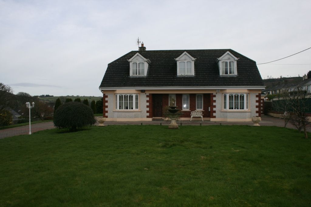: 1,940 Sq. Ft. Dormer Type House & Garage on circa .5 of an acre.
